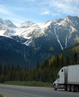 Freight truck passing through the mountains